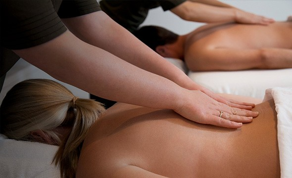 Couples massage onboard a cruise part of the relax and recharge services.